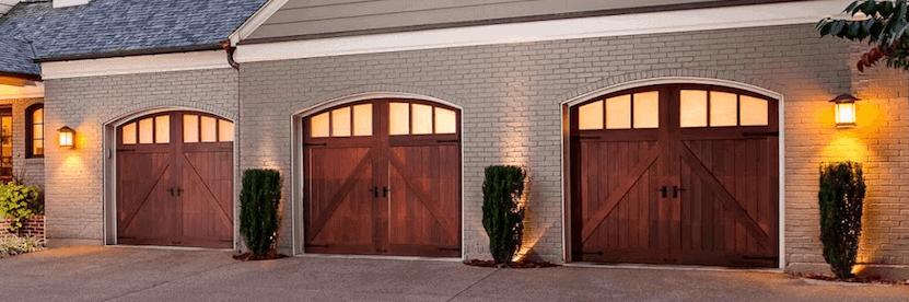 Three car garage doors- beautiful home with wood composite doors